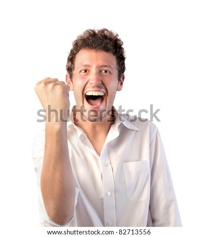 Happy young businessman triumphing - stock photo