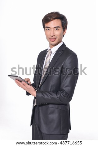 Happy Young Businessman Using Digital Tablet