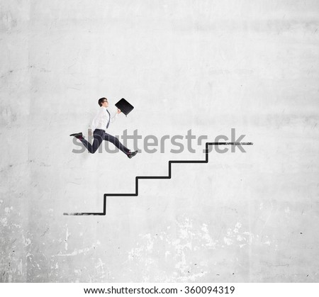 Happy young businessman with a folder running up a drawn stairs along a concrete wall. Concept of career growth. - stock photo