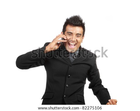 happy young businessman with phone laughing