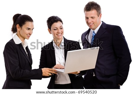 Happy young businesspeople looking at laptop computer screen, laughing. Isolated on white.