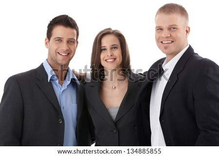Happy young businessteam standing in huddle, cutout on white background, smiling at camera.