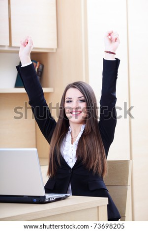 Happy young businesswoman happy because of good news from laptop - stock photo