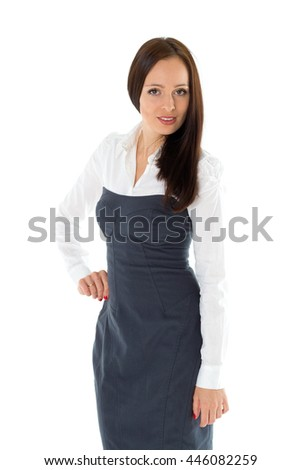 Happy young businesswoman stands on a white background.