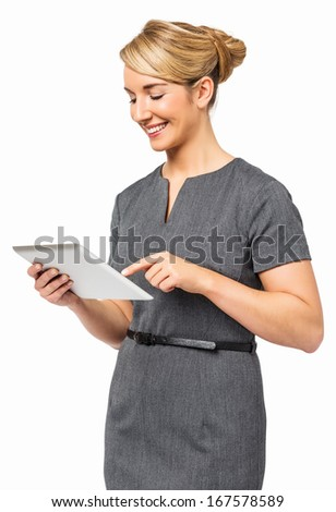 Happy young businesswoman using digital tablet against white background. Vertical shot. - stock photo