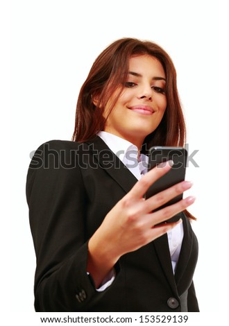 Happy young businesswoman using her smartphone isolated on white - stock photo