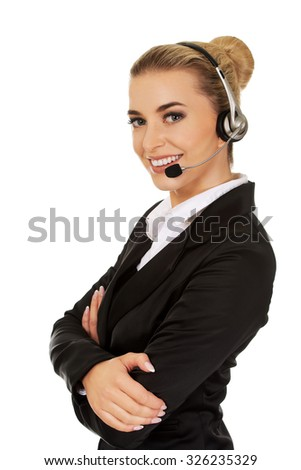 Happy young businesswoman with headset. - stock photo