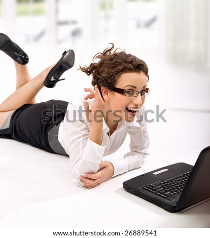 Happy young businesswoman with notebook - stock photo