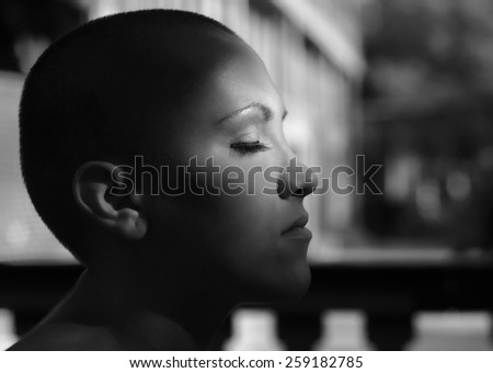 Happy young cancer survivor after successful chemotherapy enjoying sunlight. - stock photo