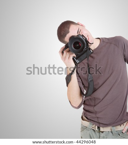 happy young casual man portrait taking photos - stock photo