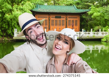 Happy, young, caucasian couple taking a self portrait photo, selfie, in the Japanese garden - stock photo