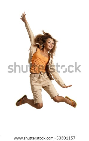 Happy young caucasian red-haired female jumping into the air - stock photo