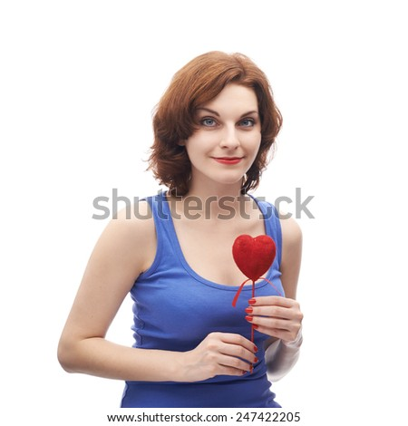 Happy young caucasian woman in her twenties holding the red heart, isolated over the white background - stock photo