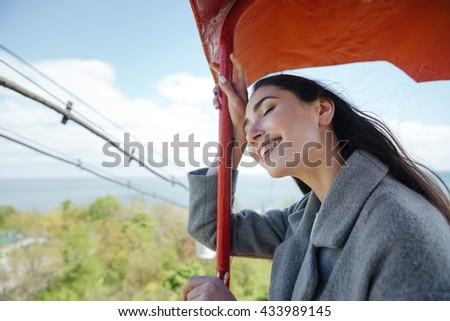 Happy young cheerful smiling girl having fun outdoors - stock photo