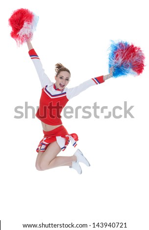 Happy Young Cheerleader Jumping With Pom-poms Over White Background - stock photo