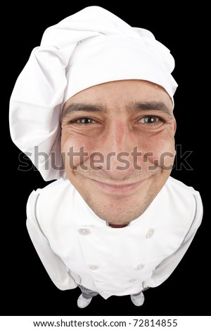 Happy young chef smiling and looking at camera.  Distorted image taken in studio with fish eye lens. Isolated on pure black background. - stock photo
