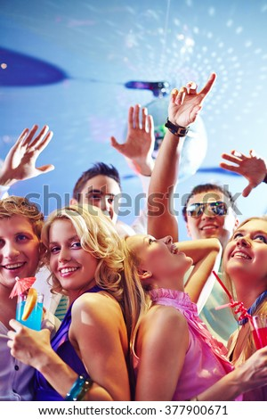 Happy young clubbers enjoying party - stock photo