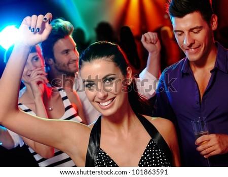 Happy young companionship having fun on dance floor. - stock photo