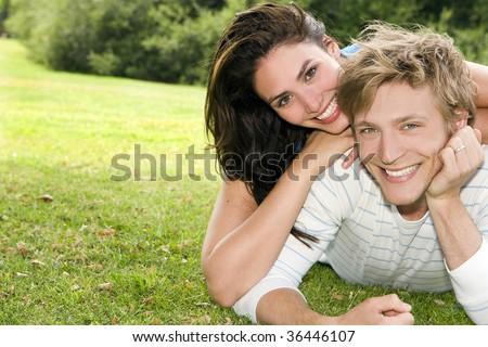 Happy young couple at a park - stock photo