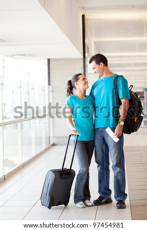 happy young couple at airport