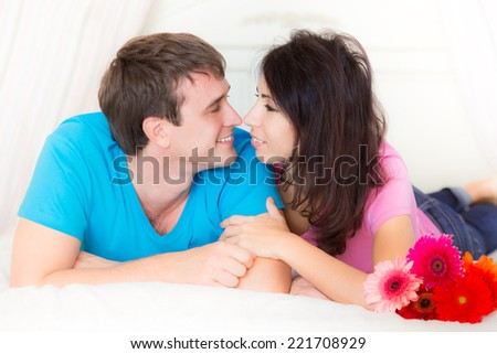 Happy young couple at home - stock photo
