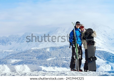 happy young couple at ski vacations - stock photo