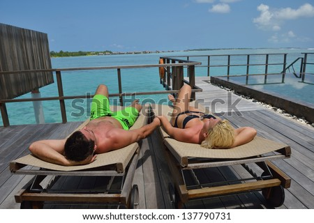 happy young  couple at summer vacation have fun and relax at beautiful sunny  day