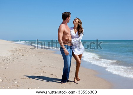 Happy young couple at the beach. - stock photo