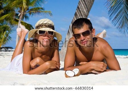 Happy young couple at the beach - stock photo