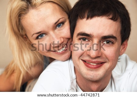 happy young couple; closeup faces