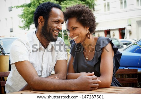 Happy young couple dating in a cafe