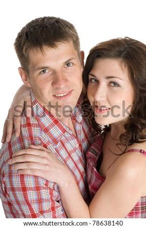 Happy young couple embracing looking up. - stock photo