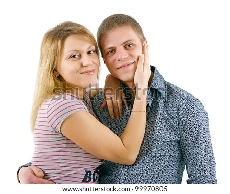 happy young couple embracing on a white background - stock photo