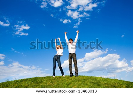 Happy young couple enjoying summer - stock photo