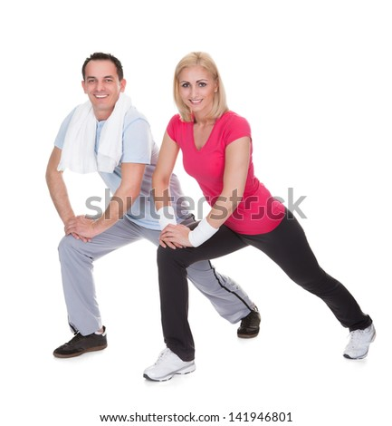 Happy Young Couple Exercising Over White Background