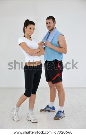 happy young couple fitness workout and fun at sport gym club