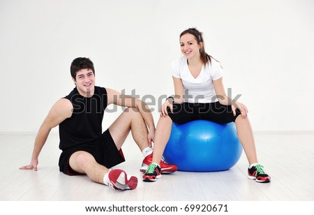 happy young couple fitness workout and fun at sport gym club - stock photo