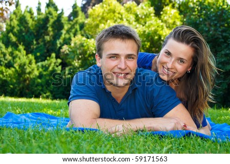 Happy young couple have nice day in the nature - stock photo