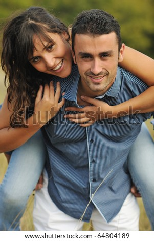 happy young couple have romantic time outdoor while smiling and hug - stock photo