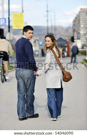 happy young couple having a good time and fun outdoor at beautiful sunny day - stock photo