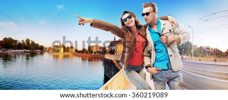 Happy young couple having a good time outdoors - stock photo