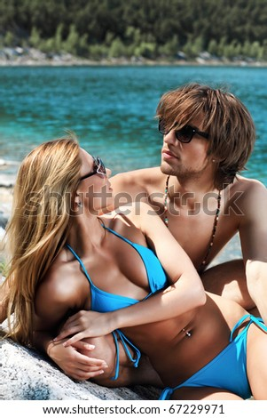 Happy young couple having a rest on a beach. - stock photo