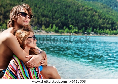 Happy young couple having a rest on a beach.