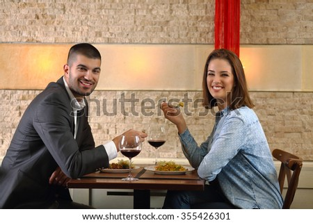 Happy young couple having a romantic dinner at the restaurant - stock photo