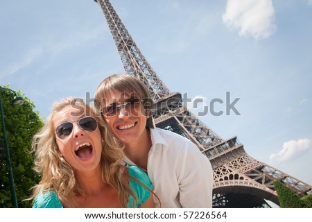 Happy young couple having fun in Paris, France - stock photo