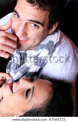 Happy young couple having fun indoor