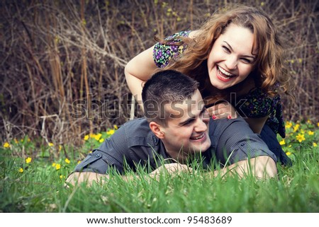 Happy young couple having fun on grass