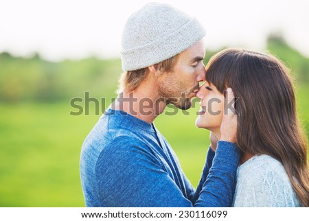 Happy Young Couple Having Fun Outdoors. Romantic Couple Kissing in Love.
