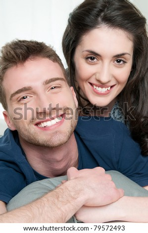 Happy young couple having fun together at home - stock photo
