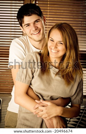 Happy young couple having inside